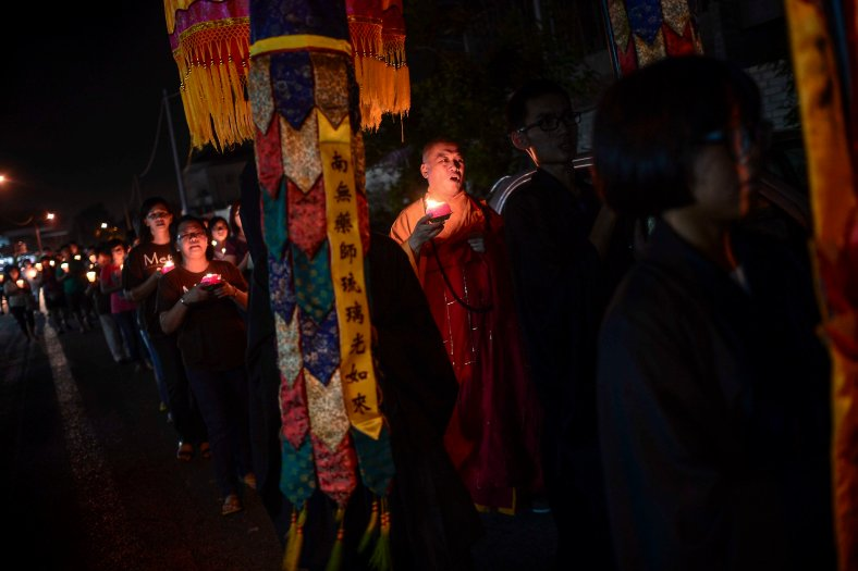 Buddhist monks carry candles while encircling temple at Temple in Butterworth on May 02, 2015. Vesak Day is the most important of the Buddhist festivals referred to as 'Buddha's Birthday' with the special day being commemorated in honoring the birth, enlightenment (nirvana) as well as passing away (Parinirvana) of Siddhartha Gautama Buddha. photo Adib Rawi Yahya