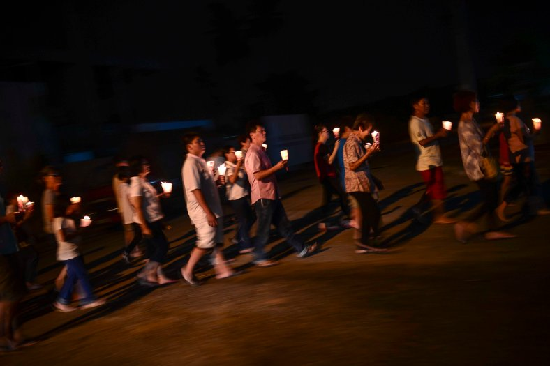 Buddhist devotees carry candles while encircling temple at Temple in Butterworth on May 02, 2015. Vesak Day is the most important of the Buddhist festivals referred to as 'Buddha's Birthday' with the special day being commemorated in honoring the birth, enlightenment (nirvana) as well as passing away (Parinirvana) of Siddhartha Gautama Buddha. photo Adib Rawi Yahya