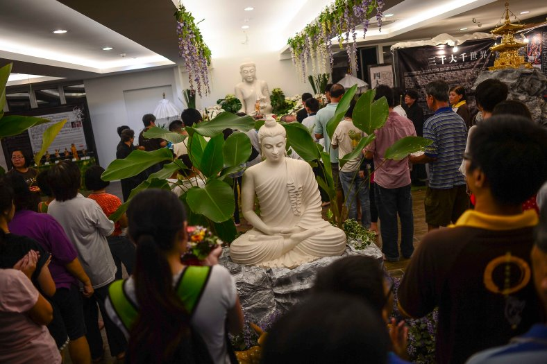 Buddhist offers prayers at Temple in Butterworth on May 02, 2015. Vesak Day is the most important of the Buddhist festivals referred to as 'Buddha's Birthday' with the special day being commemorated in honoring the birth, enlightenment (nirvana) as well as passing away (Parinirvana) of Siddhartha Gautama Buddha. photo Adib Rawi Yahya