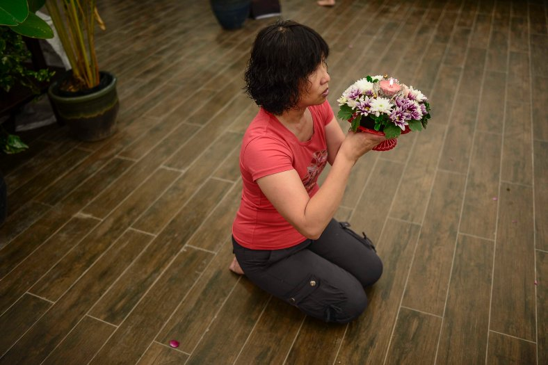 A Buddhist offers prayers at Temple in Butterworth on May 02, 2015. Vesak Day is the most important of the Buddhist festivals referred to as 'Buddha's Birthday' with the special day being commemorated in honoring the birth, enlightenment (nirvana) as well as passing away (Parinirvana) of Siddhartha Gautama Buddha. photo Adib Rawi Yahya