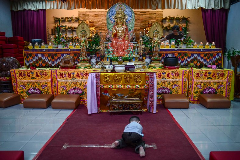A Buddhist kids offers prayers at Temple in Butterworth on May 02, 2015. Vesak Day is the most important of the Buddhist festivals referred to as 'Buddha's Birthday' with the special day being commemorated in honoring the birth, enlightenment (nirvana) as well as passing away (Parinirvana) of Siddhartha Gautama Buddha. photo Adib Rawi Yahya