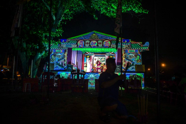 Chinese opera performance at a makeshift theater during the festive event of Hungry Ghost festival outside Kuala Lumpur on August 25, 2015. During the month-long festival, Chinese people make offerings of food,