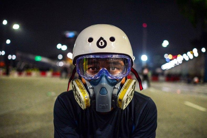 Media wear a gas mask during Bersih 4.0 rally at Dataran Merdeka on August 29, 2015. The Bersih 4.0 rally is a series of planned rallies to be carried out on 29 to 30 August in major cities in Malaysia, namely Kuching, Kota Kinabalu and Kuala Lumpur. This rally being carried out with the objective to seeking the resignation of Malaysian Prime Minister Najib Tun Razak and calling for clean governance in Malaysia and follow up to similar rallies that were carried out in 2007, 2011 and 2012. The assembly is being held for 34 hours, starting at 2:00 pm on August 29 until the Merdeka countdown on August 31. However, the rally ended peacefully. photo adib rawi yahya