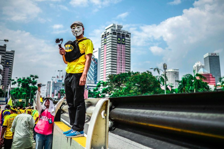 Protester wearing a mask during Bersih 4.0 rally at Dataran Merdeka on August 29, 2015. The Bersih 4.0 rally is a series of planned rallies to be carried out on 29 to 30 August in major cities in Malaysia, namely Kuching, Kota Kinabalu and Kuala Lumpur. This rally being carried out with the objective to seeking the resignation of Malaysian Prime Minister Najib Tun Razak and calling for clean governance in Malaysia and follow up to similar rallies that were carried out in 2007, 2011 and 2012. The assembly is being held for 34 hours, starting at 2:00 pm on August 29 until the Merdeka countdown on August 31. However, the rally ended peacefully. photo adib rawi yahya