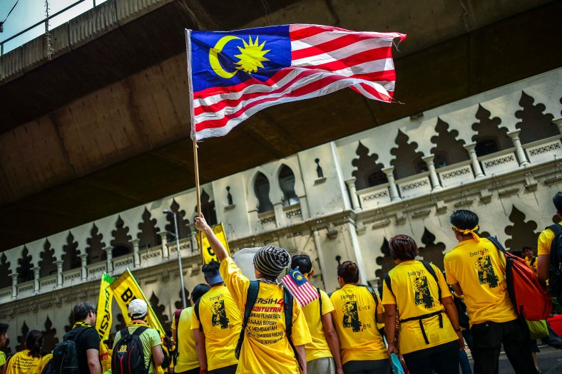 Protester wave a Malaysia flag near Dataran Merdeka during Bersih 4.0 rally on August 29, 2015. The Bersih 4.0 rally is a series of planned rallies to be carried out on 29 to 30 August in major cities in Malaysia, namely Kuching, Kota Kinabalu and Kuala Lumpur. This rally being carried out with the objective to seeking the resignation of Malaysian Prime Minister Najib Tun Razak and calling for clean governance in Malaysia and follow up to similar rallies that were carried out in 2007, 2011 and 2012. The assembly is being held for 34 hours, starting at 2:00 pm on August 29 until the Merdeka countdown on August 31. However, the rally ended peacefully. photo adib rawi yahya