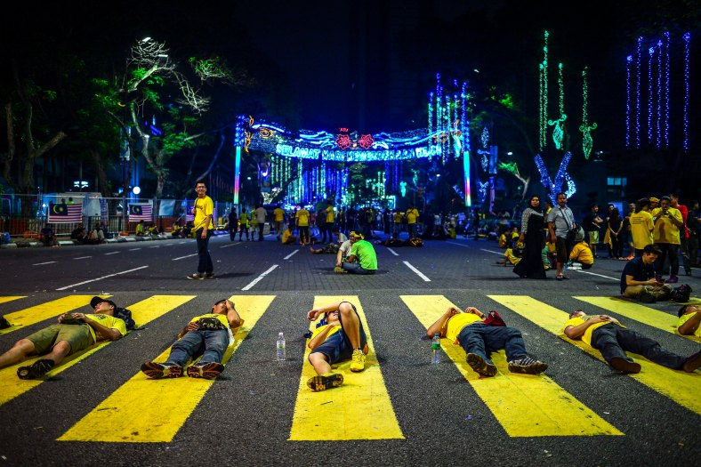 Protesters take a rest and sleep along Jalan Tunku Abdul Rahman during Bersih 4.0 rally on August 29, 2015. The Bersih 4.0 rally is a series of planned rallies to be carried out on 29 to 30 August in major cities in Malaysia, namely Kuching, Kota Kinabalu and Kuala Lumpur. This rally being carried out with the objective to seeking the resignation of Malaysian Prime Minister Najib Tun Razak and calling for clean governance in Malaysia and follow up to similar rallies that were carried out in 2007, 2011 and 2012. The assembly is being held for 34 hours, starting at 2:00 pm on August 29 until the Merdeka countdown on August 31. However, the rally ended peacefully. photo adib rawi yahya