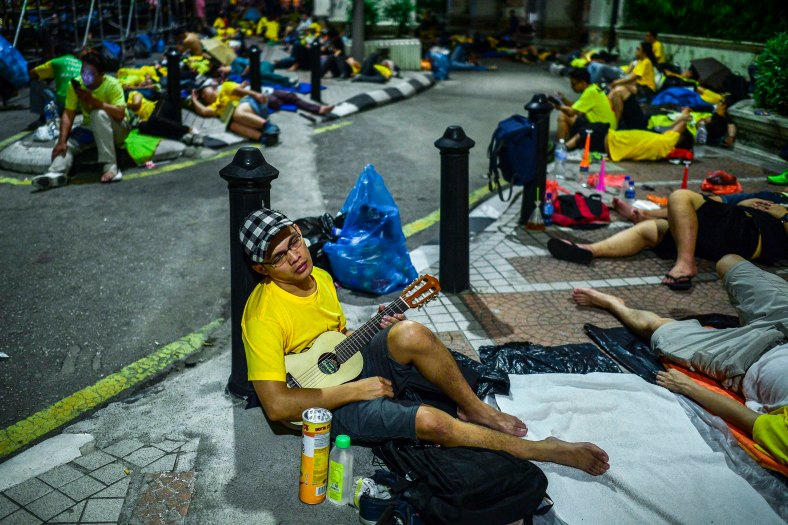 Protester sleep with his ukulele near Dataran Merdeka during Bersih 4.0 rally on August 29, 2015. The Bersih 4.0 rally is a series of planned rallies to be carried out on 29 to 30 August in major cities in Malaysia, namely Kuching, Kota Kinabalu and Kuala Lumpur. This rally being carried out with the objective to seeking the resignation of Malaysian Prime Minister Najib Tun Razak and calling for clean governance in Malaysia and follow up to similar rallies that were carried out in 2007, 2011 and 2012. The assembly is being held for 34 hours, starting at 2:00 pm on August 29 until the Merdeka countdown on August 31. However, the rally ended peacefully. photo adib rawi yahya