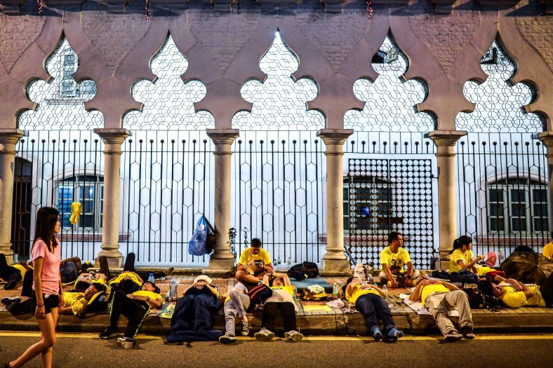Protesters take a rest and sleep near Dataran Merdeka during Bersih 4.0 rally on August 29, 2015. The Bersih 4.0 rally is a series of planned rallies to be carried out on 29 to 30 August in major cities in Malaysia, namely Kuching, Kota Kinabalu and Kuala Lumpur. This rally being carried out with the objective to seeking the resignation of Malaysian Prime Minister Najib Tun Razak and calling for clean governance in Malaysia and follow up to similar rallies that were carried out in 2007, 2011 and 2012. The assembly is being held for 34 hours, starting at 2:00 pm on August 29 until the Merdeka countdown on August 31. However, the rally ended peacefully. photo adib rawi yahya