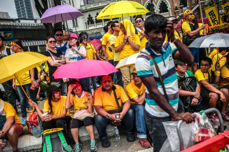Protesters gather while holds a umbrella near Dataran Merdeka during the second day Bersih 4.0 rally on August 30, 2015. The Bersih 4.0 rally is a series of planned rallies to be carried out on 29 to 30 August in major cities in Malaysia, namely Kuching, Kota Kinabalu and Kuala Lumpur. This rally being carried out with the objective to seeking the resignation of Malaysian Prime Minister Najib Tun Razak and calling for clean governance in Malaysia and follow up to similar rallies that were carried out in 2007, 2011 and 2012. The assembly is being held for 34 hours, starting at 2:00 pm on August 29 until the Merdeka countdown on August 31. However, the rally ended peacefully. photo adib rawi yahya