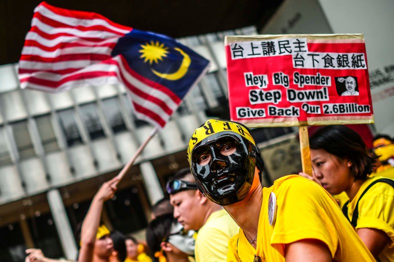Protesters gather and wear a gas mask during the second day Bersih 4.0 rally at Dataran Merdeka on August 30, 2015. The Bersih 4.0 rally is a series of planned rallies to be carried out on 29 to 30 August in major cities in Malaysia, namely Kuching, Kota Kinabalu and Kuala Lumpur. This rally being carried out with the objective to seeking the resignation of Malaysian Prime Minister Najib Tun Razak and calling for clean governance in Malaysia and follow up to similar rallies that were carried out in 2007, 2011 and 2012. The assembly is being held for 34 hours, starting at 2:00 pm on August 29 until the Merdeka countdown on August 31. However, the rally ended peacefully. photo adib rawi yahya