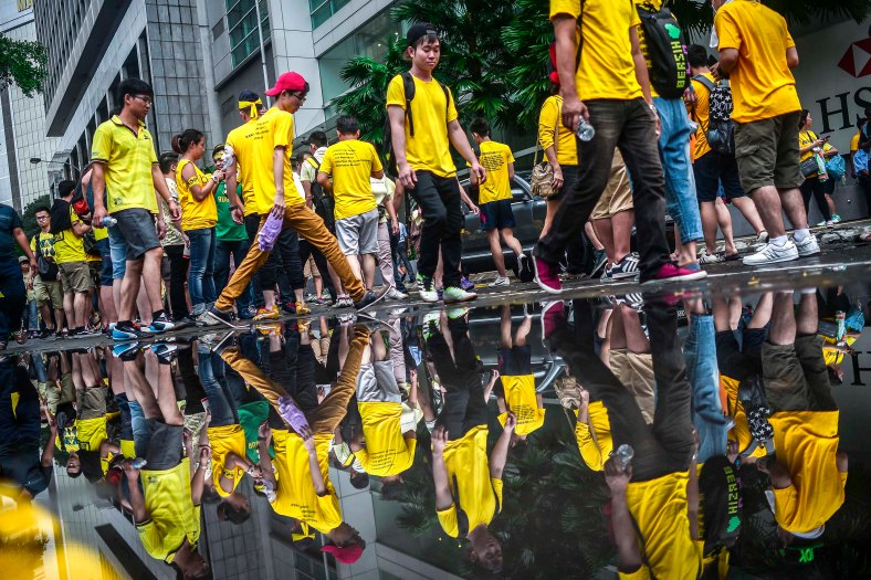 Protesters are reflected on a water during the second day Bersih 4.0 rally at Dataran Merdeka on August 30, 2015. The Bersih 4.0 rally is a series of planned rallies to be carried out on 29 to 30 August in major cities in Malaysia, namely Kuching, Kota Kinabalu and Kuala Lumpur. This rally being carried out with the objective to seeking the resignation of Malaysian Prime Minister Najib Tun Razak and calling for clean governance in Malaysia and follow up to similar rallies that were carried out in 2007, 2011 and 2012. The assembly is being held for 34 hours, starting at 2:00 pm on August 29 until the Merdeka countdown on August 31. However, the rally ended peacefully. photo adib rawi yahya