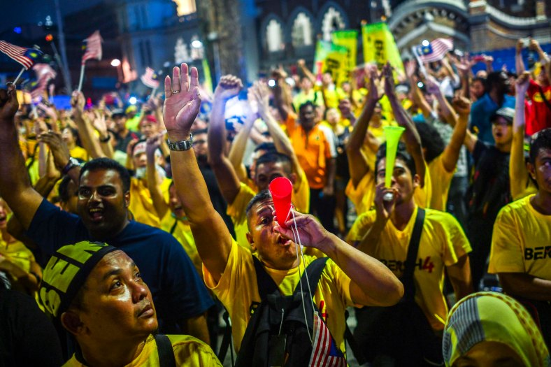 """Protesters shout slogan """"Merdeka"""" after Merdeka countdown near Dataran Merdeka during the second day Bersih 4.0 rally on August 31, 2015. The Bersih 4.0 rally is a series of planned rallies to be carried out on 29 to 30 August in major cities in Malaysia, namely Kuching, Kota Kinabalu and Kuala Lumpur. This rally being carried out with the objective to seeking the resignation of Malaysian Prime Minister Najib Tun Razak and calling for clean governance in Malaysia and follow up to similar rallies that were carried out in 2007, 2011 and 2012. The assembly is being held for 34 hours, starting at 2:00 pm on August 29 until the Merdeka countdown on August 31. However, the rally ended peacefully. photo adib rawi yahya"""