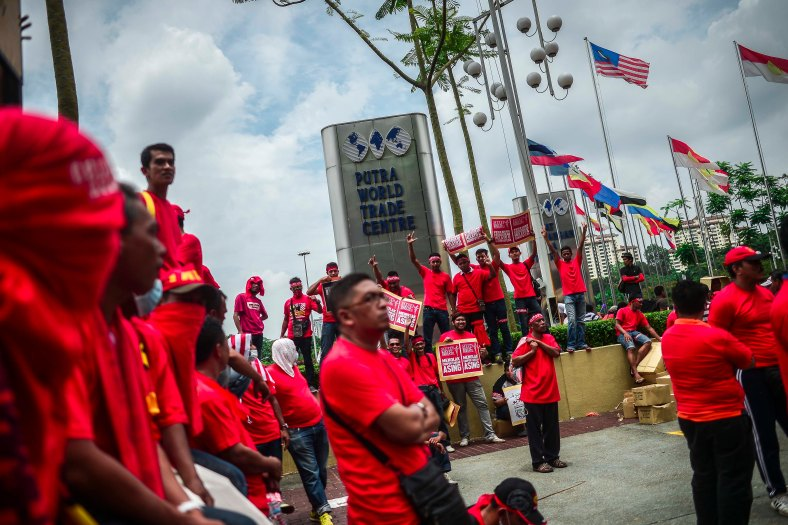 Protesters gather near PWTC before march towards Padang Merbok in Kuala Lumpur on September 16, 2015. In what was to be a day to celebrate the anniversary of the 52th formation of Malaysia as a nation, thousands of people in Red Rallied in Kuala Lumpur on September 16 in a show of support for Prime Minister Datuk Seri Najib Razak. The rally organised by Himpunan Rakyat Bersatu and backed by pro government bodies saw thousands dressed in red in the heart of the city. The rally was condemned by some for its racial slurs but leaders from the ruling UMNO have denied this and have openly backed the rally. photo Adib Rawi yahya