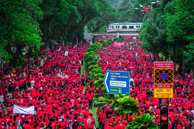 Protesters march towards Padang Merbok in Kuala Lumpur on September 16, 2015. In what was to be a day to celebrate the anniversary of the 52th formation of Malaysia as a nation, thousands of people in Red Rallied in Kuala Lumpur on September 16 in a show of support for Prime Minister Datuk Seri Najib Razak. The rally organised by Himpunan Rakyat Bersatu and backed by pro government bodies saw thousands dressed in red in the heart of the city. The rally was condemned by some for its racial slurs but leaders from the ruling UMNO have denied this and have openly backed the rally. photo Adib Rawi yahya