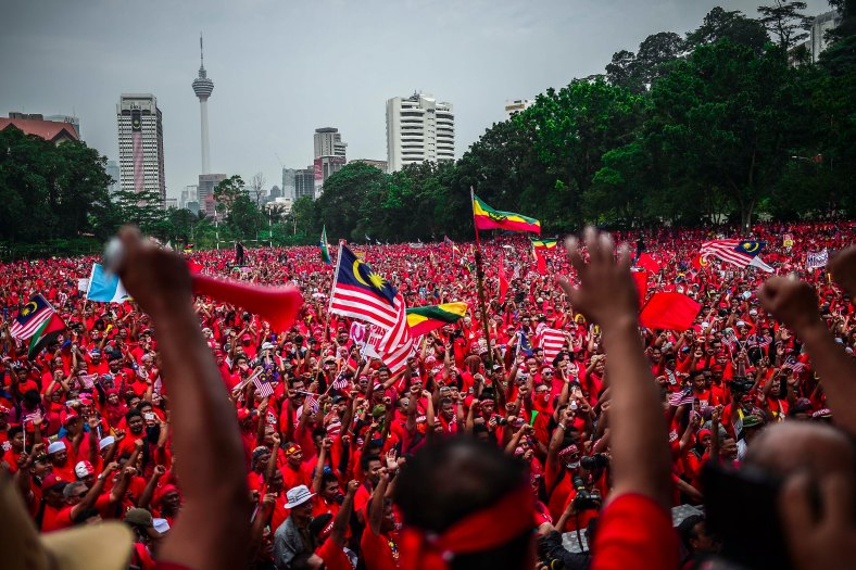 Protesters shout slogan at Padang Merbok in Kuala Lumpur on September 16, 2015. In what was to be a day to celebrate the anniversary of the 52th formation of Malaysia as a nation, thousands of people in Red Rallied in Kuala Lumpur on September 16 in a show of support for Prime Minister Datuk Seri Najib Razak. The rally organised by Himpunan Rakyat Bersatu and backed by pro government bodies saw thousands dressed in red in the heart of the city. The rally was condemned by some for its racial slurs but leaders from the ruling UMNO have denied this and have openly backed the rally. photo Adib Rawi yahya