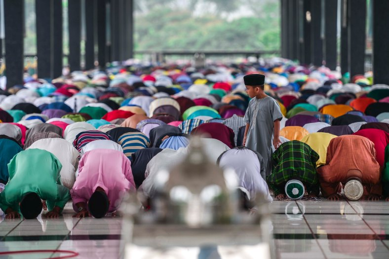 Malaysian Muslims perform Eid Al-Adha prayer in Kuala Lumpur on September 24, 2015. Muslims around the world celebrate the Eid al-Adha, the most important holiday of the Islamic calendar, and also called the Feast of the Sacrifice to commemorate Prophet Abraham's readiness to sacrifice his son as an act of obedience to God during which they sacrifice permissible animals, generally goats, sheep, camel and cows. photo adib rawi yahya
