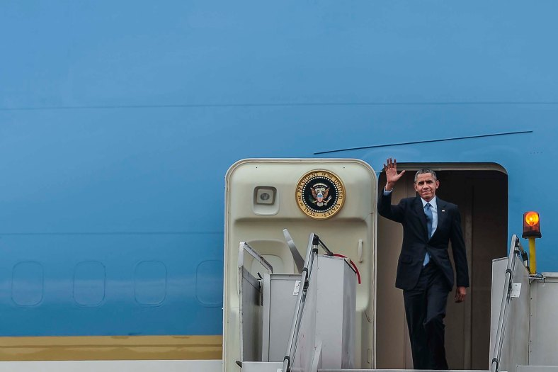 US President Barack Obama waves as he arrives with Air Force One at the Royal Malaysian Air Force (RMAF) base in Subang outside Kuala Lumpur on November 20, 2015. Barrack Obama will attend the 27th Association of South East Asian Nations (ASEAN) Summit that has takes place in Malaysia from November 18-22 2015. photo Adib Rawi Yahya