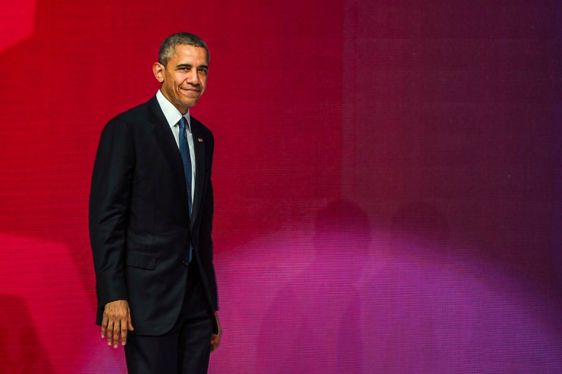 US President Barack Obama smiles as he walk after his speech during the Asean Business and Investment Summit in Kuala Lumpur on November 21, 2015. Barrack Obama attend the 27th Association of South East Asian Nations (ASEAN) Summit that has takes place in Malaysia from November 18-22 2015. photo Adib Rawi Yahya