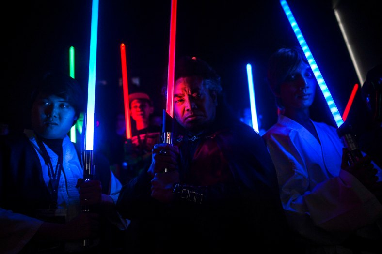 Members of Star Wars fan club pose for pictures before the film premiere of 'Star Wars: The Force Awakens' outside Kuala Lumpur on December 16, 2015. The film is the seventh in the Star Wars series. photo Adib Rawi Yahya