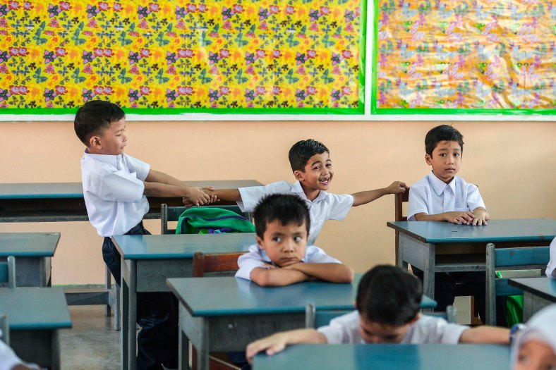 Year One pupils enter their classroom for the first time during the first day school session outside Kuala Lumpur on January 4, 2016. photo Adib Rawi Yahya