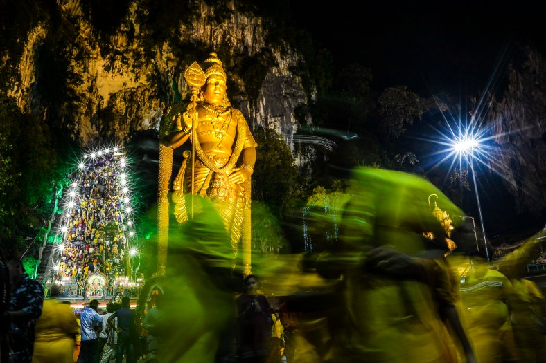 A giant Lord Murugan statue is seen at Batu Caves during the Thaipusam Festival outskirts of Kuala Lumpur on January 24, 2016. The Hindu festival of Thaipusam, which commemorates the day when Goddess Pavarthi gave her son Lord Muruga an invincible lance with which he destroyed evil demons, is celebrated by some two million ethnic Indians in Malaysia and Singapore. photo Adib Rawi Yahya
