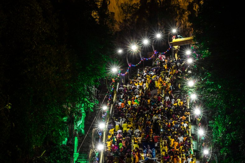 Malaysian Hindu devotees perform their religious rites while walking towards to the temple to make offerings during the Thaipusam Festival at Batu Caves outskirts of Kuala Lumpur on January 24, 2016. The Hindu festival of Thaipusam, which commemorates the day when Goddess Pavarthi gave her son Lord Muruga an invincible lance with which he destroyed evil demons, is celebrated by some two million ethnic Indians in Malaysia and Singapore. photo Adib Rawi Yahya
