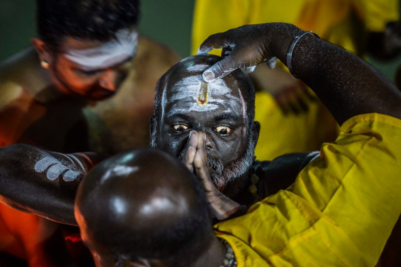 Malaysian Hindu devotees perform a ritual bath before walking towards to the temple to make offerings during the Thaipusam Festival at Batu Caves outskirts of Kuala Lumpur on January 24, 2016. The Hindu festival of Thaipusam, which commemorates the day when Goddess Pavarthi gave her son Lord Muruga an invincible lance with which he destroyed evil demons, is celebrated by some two million ethnic Indians in Malaysia and Singapore. photo Adib Rawi Yahya