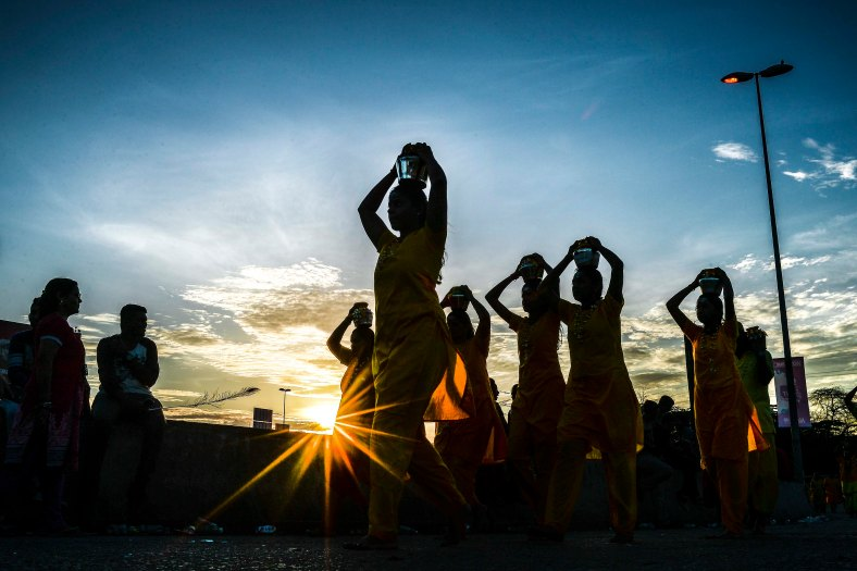 Malaysian Hindu devotees carry milk pots on their heads as perform their religious rites while walking towards to the temple to make offerings during the Thaipusam Festival at Batu Caves outskirts of Kuala Lumpur on January 24, 2016. The Hindu festival of Thaipusam, which commemorates the day when Goddess Pavarthi gave her son Lord Muruga an invincible lance with which he destroyed evil demons, is celebrated by some two million ethnic Indians in Malaysia and Singapore. photo Adib Rawi Yahya