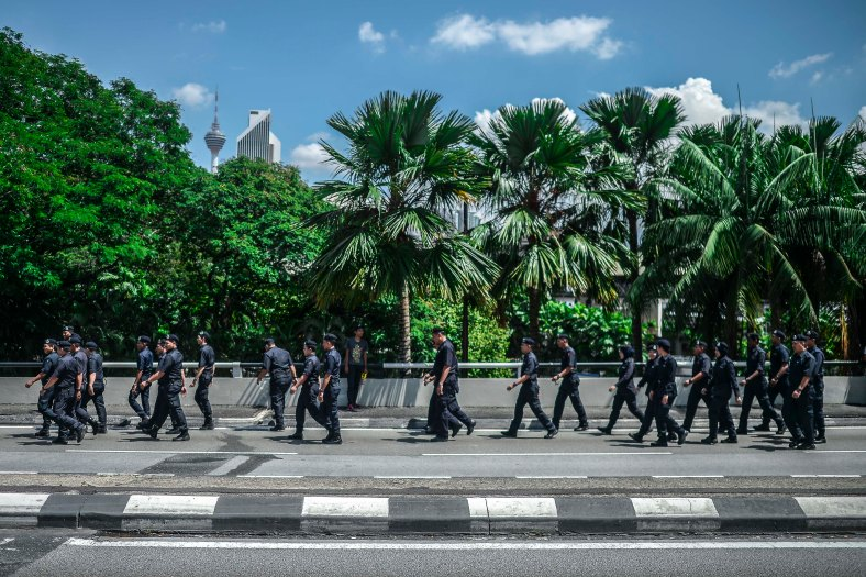 Malaysian Royal Police officers walk in group to stand by as protesters rally to step up pressure on Prime Minister Najib Razak to resign over alleged corruption during the Bersih 5.0 rally in Kuala Lumpur on November 19, 2016. Bersih 5.0 is the fifth such rally since 2007 where anti-government protesters demand clean elections, clean government, strengthened parliamentary democracy, the right to dissent and empowering the eastern state of Sabah and Sarawak. photo adib rawi yahya
