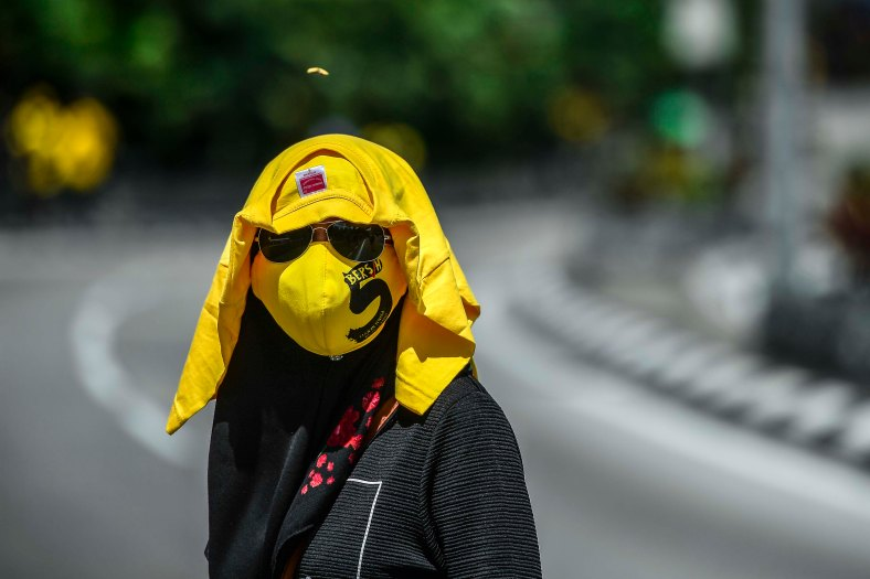 Bersih 5.0 protester look on as they gather at a street to step up pressure on Prime Minister Najib Razak to resign over alleged corruption during the Bersih 5.0 rally in Kuala Lumpur on November 19, 2016. Bersih 5.0 is the fifth such rally since 2007 where anti-government protesters demand clean elections, clean government, strengthened parliamentary democracy, the right to dissent and empowering the eastern state of Sabah and Sarawak. photo adib rawi yahya