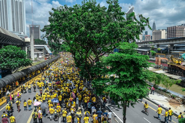 Malaysian yellow shirts protesters gather at a street to step up pressure on Prime Minister Najib Razak to resign over alleged corruption during the Bersih 5.0 rally in Kuala Lumpur on November 19, 2016. Bersih 5.0 is the fifth such rally since 2007 where anti-government protesters demand clean elections, clean government, strengthened parliamentary democracy, the right to dissent and empowering the eastern state of Sabah and Sarawak. photo adib rawi yahya
