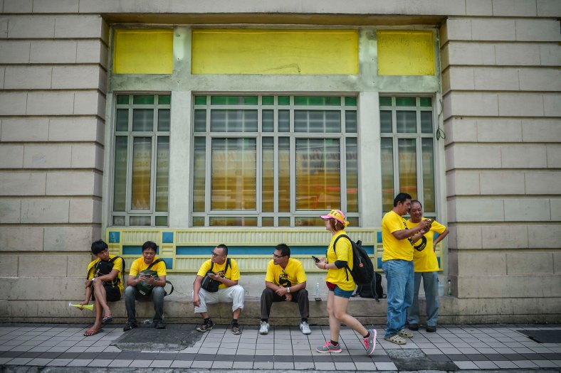 Malaysian yellow shirts protesters sits as they gather at a street to step up pressure on Prime Minister Najib Razak to resign over alleged corruption during the Bersih 5.0 rally in Kuala Lumpur on November 19, 2016. Bersih 5.0 is the fifth such rally since 2007 where anti-government protesters demand clean elections, clean government, strengthened parliamentary democracy, the right to dissent and empowering the eastern state of Sabah and Sarawak. photo adib rawi yahya