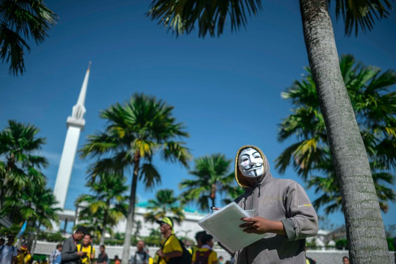 A protester wearing mask as gather near mosque to step up pressure on Prime Minister Najib Razak to resign over alleged corruption during the Bersih 5.0 rally in Kuala Lumpur on November 19, 2016. Bersih 5.0 is the fifth such rally since 2007 where anti-government protesters demand clean elections, clean government, strengthened parliamentary democracy, the right to dissent and empowering the eastern state of Sabah and Sarawak. photo adib rawi yahya