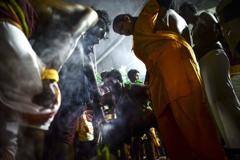Malaysian Hindu devotees perform their religious rites while walking towards to the temple to make offerings during the Thaipusam festival at Batu Caves outskirts of Kuala Lumpur on February 09, 2017. The Hindu festival of Thaipusam, which commemorates the day when Goddess Pavarthi gave her son Lord Muruga an invincible lance with which he destroyed evil demons, is celebrated by some two million ethnic Indians in Malaysia and Singapore. photo Adib Rawi Yahya