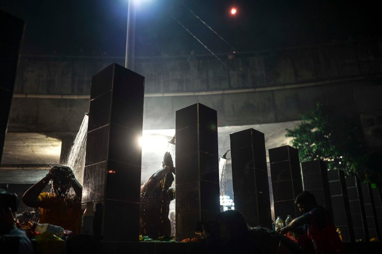 Malaysian Hindu devotees perform a ritual bath before walking towards to the temple to make offerings during the Thaipusam festival at Batu Caves outskirts of Kuala Lumpur on February 09, 2017. The Hindu festival of Thaipusam, which commemorates the day when Goddess Pavarthi gave her son Lord Muruga an invincible lance with which he destroyed evil demons, is celebrated by some two million ethnic Indians in Malaysia and Singapore. photo Adib Rawi Yahya