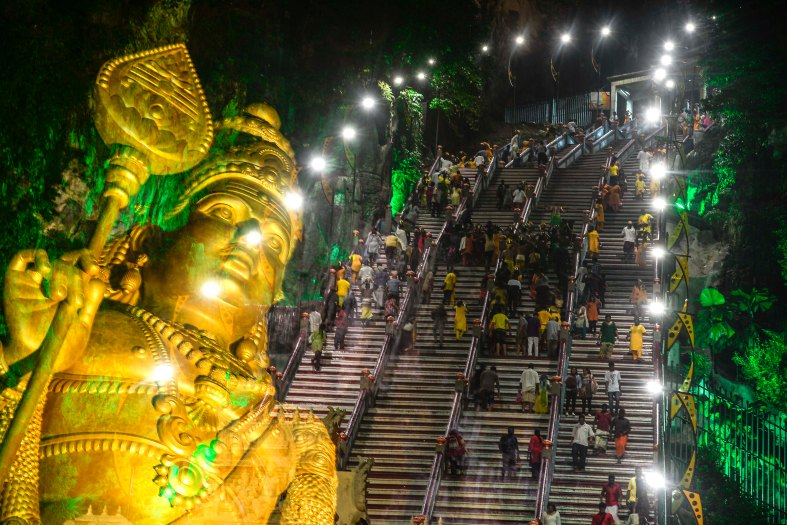 A picture taken with the multiple exposure function of the camera shows Malaysian Hindu devotees perform their religious rites while walking towards to the temple to make offerings during the Thaipusam festival at Batu Caves outskirts of Kuala Lumpur on February 08, 2017. The Hindu festival of Thaipusam, which commemorates the day when Goddess Pavarthi gave her son Lord Muruga an invincible lance with which he destroyed evil demons, is celebrated by some two million ethnic Indians in Malaysia and Singapore. photo Adib Rawi Yahya